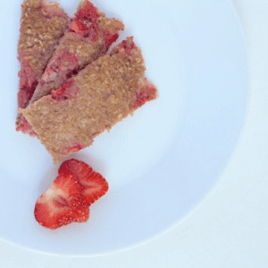 Main image for the article [Basic Oatmeal Fingers for Baby & Family]. Pictured is three oatmeal fingers with two strawberry slices.