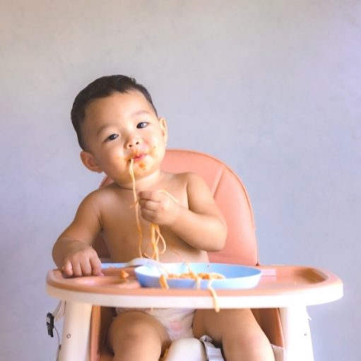 baby sit in a high chair and eat solid foods