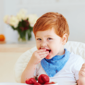 Main image for the article [How to Avoid Catering Meals]. Pictured is toddler eating strawberries and plums.