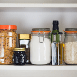 Main image for the article [Family friendly meal ideas to make out of common pantry items]. Pictured is storage jars filled with oils, grains, cereal and sugar.