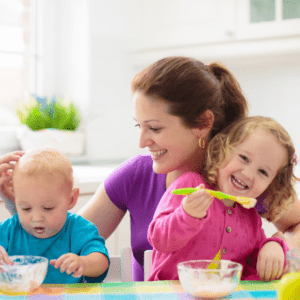 """Episode art for episode """"#4: Feeding Kids During a Pandemic"""". Pictured is a mother eating with her two children."""