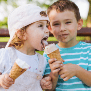 Main image for the article [Top 3 Strategies for Serving Dessert to Kids]. Pictured is a toddler eating an ice cream cone.