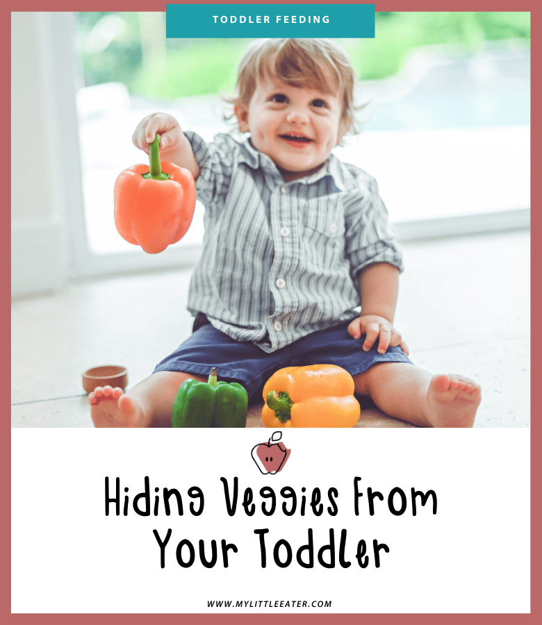 "A young toddler is shown sitting on the floor playing with 3 peppers. The title of the article ""Hiding Veggies from your Toddler"" is seen below."