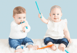 Baby Teething Tubes pictured being used by two babies.
