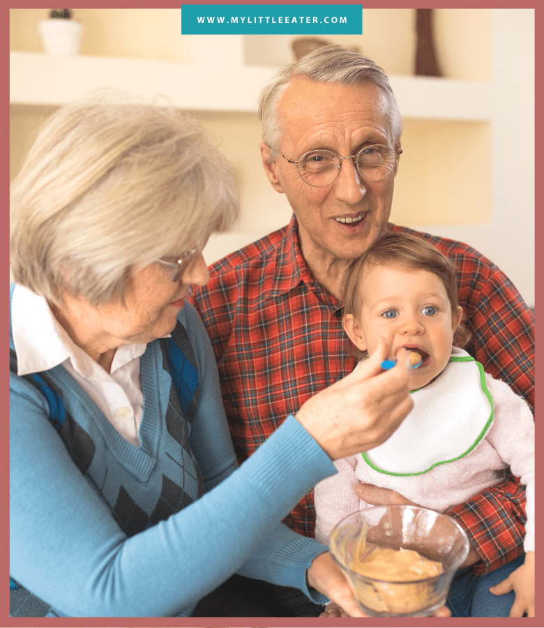 "Podcast art for episode ""#33: Will Grandparents ruin my healthy feeding efforts?"". Pictured are grandparents feeding a baby pureed food with a spoon while the baby sits on their lap."