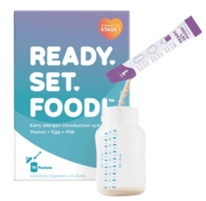 Ready, Set, Food! image of the powder being poured into a baby bottle.