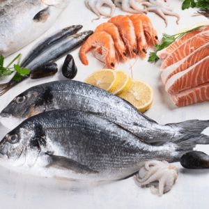"Featured image for the article: ""The ultimate guide to the safest fish for your baby."" Pictured is a variety of fish and seafood."