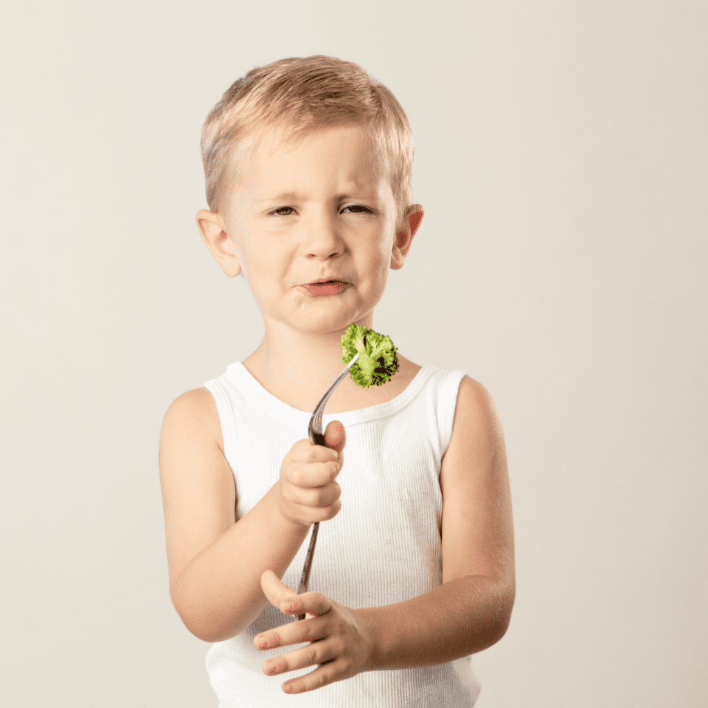 """Episode art for episode: """"#37: Preventing picky eating vs. reversing it"""". Pictured is a toddler holding broccoli on a fork with a disgusted look on their face."""