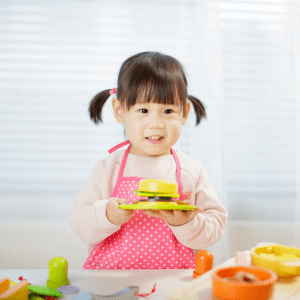 """Episode art for episode: """"Bonus: Get your toddler to eat MEAT with these 5 FOOD PLAY IDEAS!"""". Pictured is a toddler playing with toy food."""