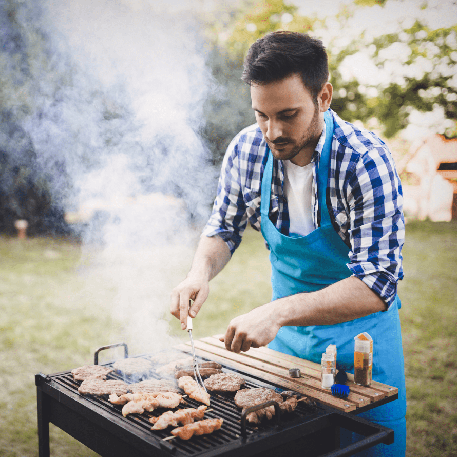 """Episode art for episode: """"#56: BBQ for Babies and Toddlers - Unique Food Ideas and How to Keep it Healthy and Safe"""". Pictured is a man in a blue and white plaid shirt seasoning meat on a BBQ grill."""