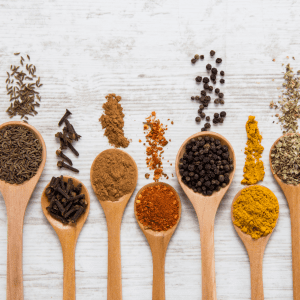 """Episode art for episode: """"#59: Can babies have spices? Which ones? How much?"""". Pictured are various spices in spoons."""