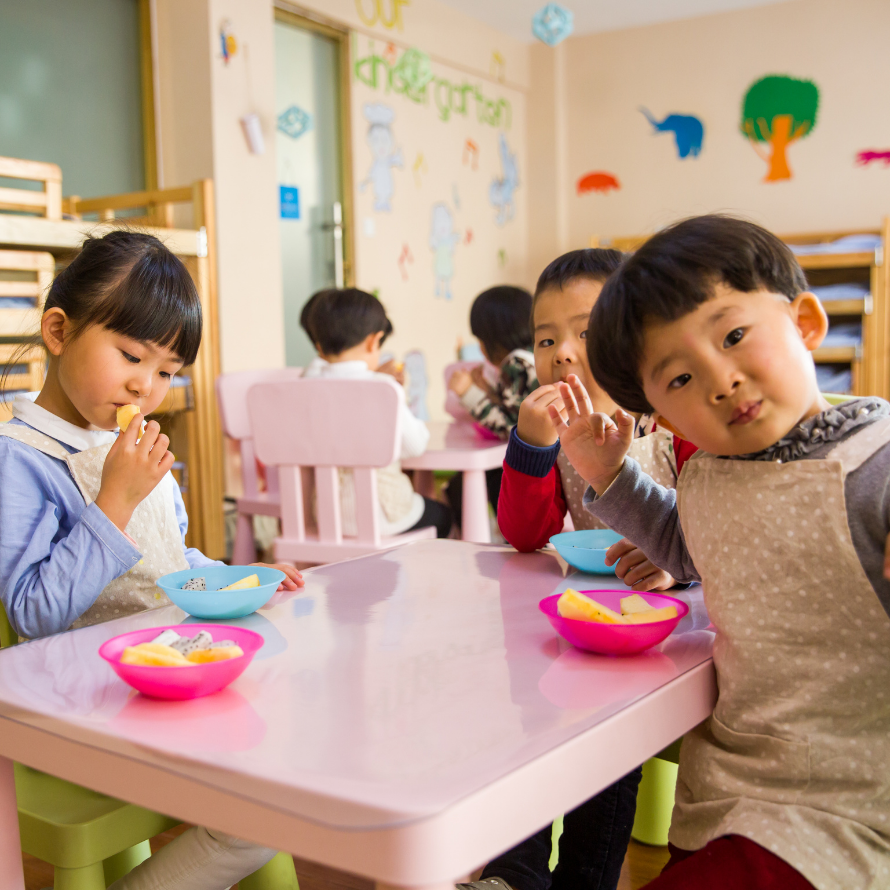"""Episode art for episode: """"#61:Should Your Toddler Sit at a Kid's Table or at the Family Table?"""". Pictured are multiple children eating at a kid's table."""