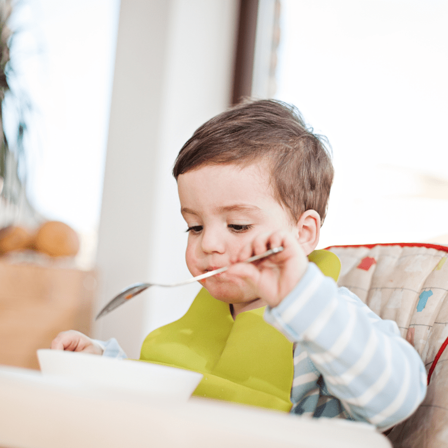 """Episode art for episode: """"#62: Do Toddlers Need Bedtime Snacks? Learn When To Offer Them, What Types of Foods To Offer, and When They Can Be Problematic! """" Pictured is a little boy in pajamas eating a snack from a bowl."""
