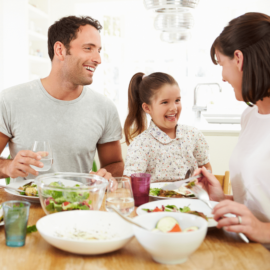 """Featured image for article: """"Kid's Table or Family Table - Does it really matter?"""". Pictured is a family dining together."""