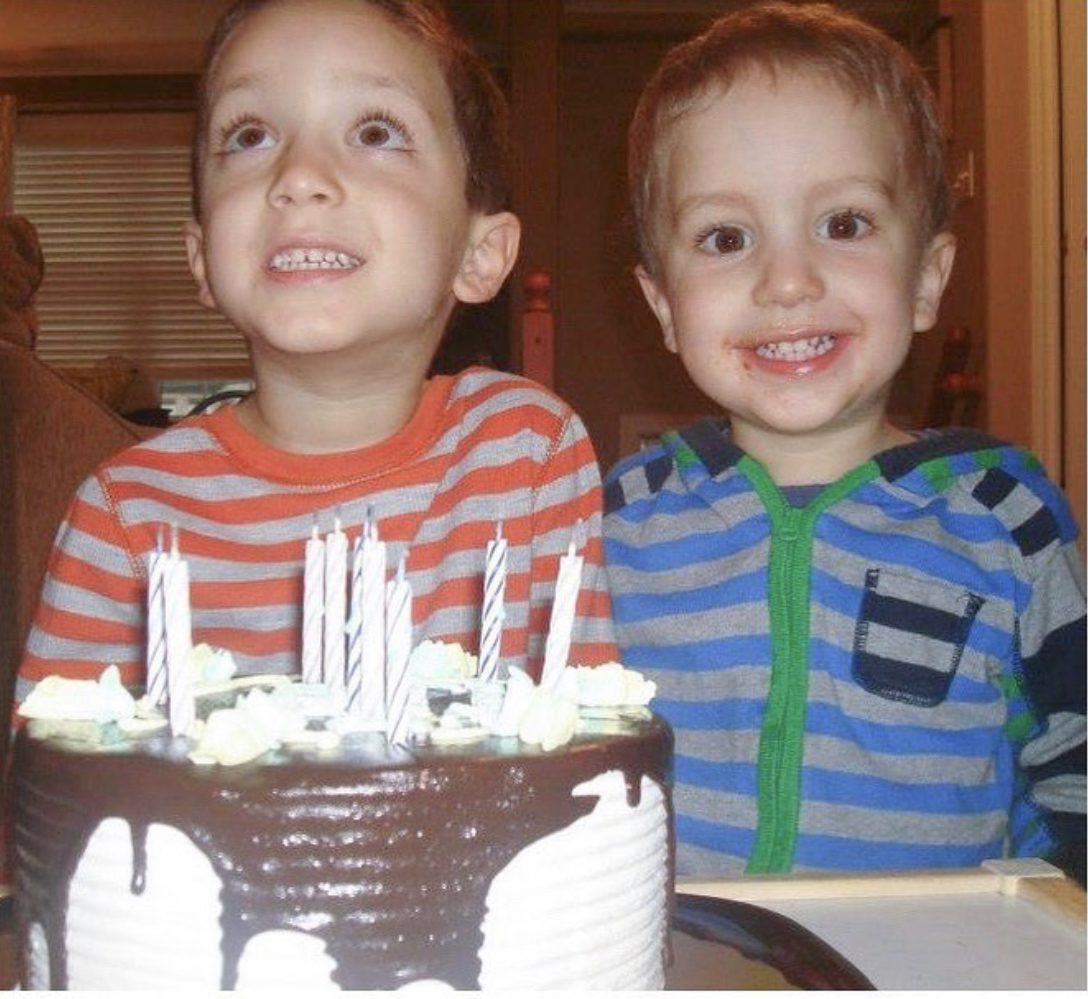 kids of a dietitian mom enjoying first birthday cake